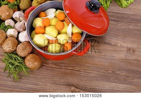Red Casserole Dish With Winter Vegetables And Herbs