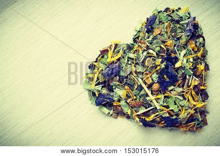 Dried Herb Leaves Heart Shaped On Burlap Surface