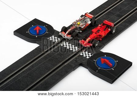 Moscow Russia - Aug 14 2010: Slot car racing track with formula one cars at start line.