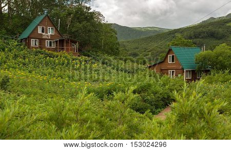 Kamchatka Peninsula, Russia - August 12, 2016: Guest houses in the Valley of Geysers. Kronotsky Nature Reserve on Kamchatka Peninsula.