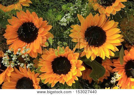 Big yellow sunflowers in a wedding floral arrangement