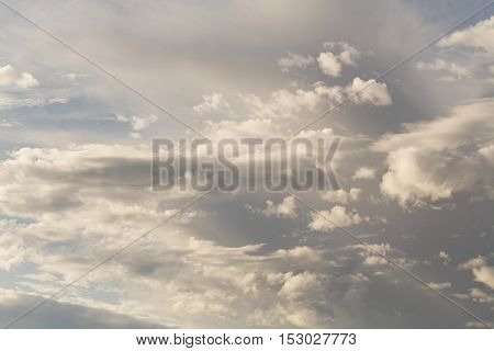 Cumulus clouds against a blue sky. Mostly Cloudy. Synoptics. poster