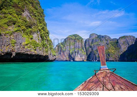 Traditional longtail boat in the turquoise colored waters of Maya Bay, Ko Phi Phi, Thailand