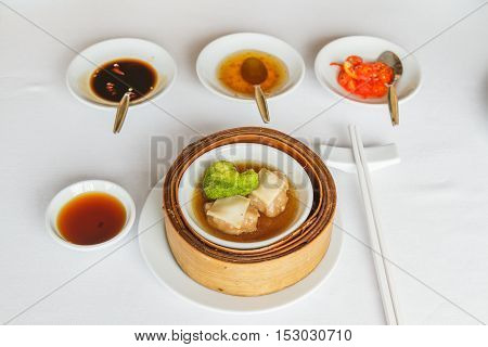 Steamed Sliced Abalone In Brown Sauce