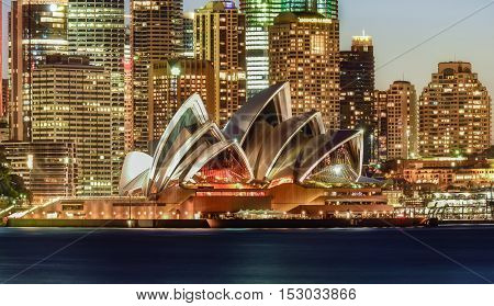 SYDNEY AUSTRALIA - October 23 2016: View Sydney CBD and The Opera House on sunset Sydney Australia Over 10 millions tourists visit Sydney every year