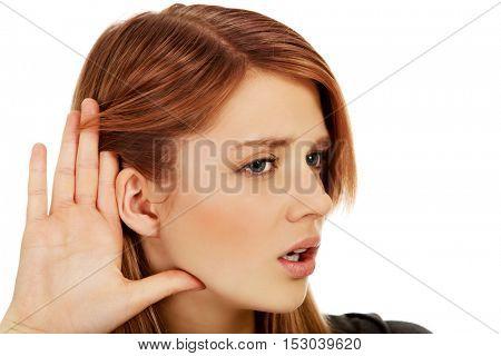 Teenage woman overhears the conversation
