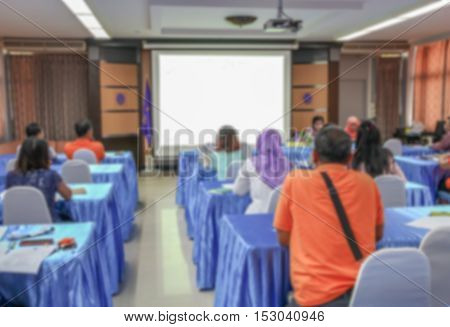 blurred focus   business education training conference in room seminar meeting and which has projector screen
