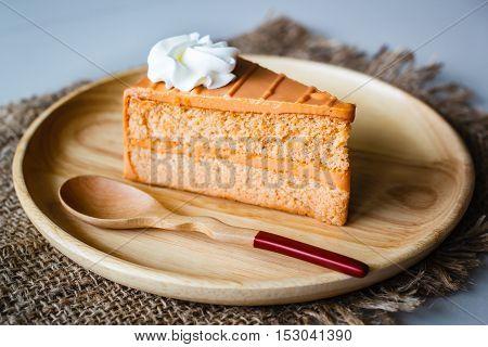 Thai Tea Layer Cake On Wood Plate.
