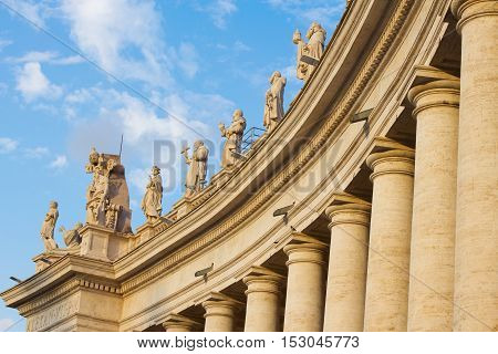 Ancient columns and statues of Papal Basilica of St. Peter in the Vatican Italy.