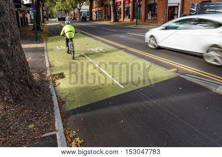 NOTTINGHAM ENGLAND - OCTOBER 19: Male cyclist using cycle lane along Castle Boulevard Nottingham England. In Nottingham England. On 19th October 2016.