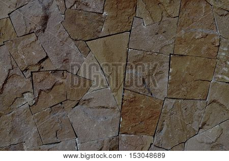 Background art on wall built of stone.