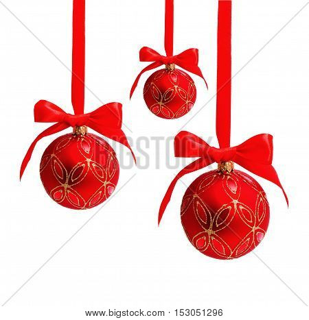Three hunging red christmas balls isolated on a white background