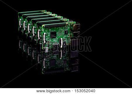 Circuit board with rj45 hdmi and usb connectors in a row on black reflective background