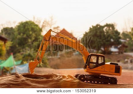 Excavator model on wooden with background outdoor