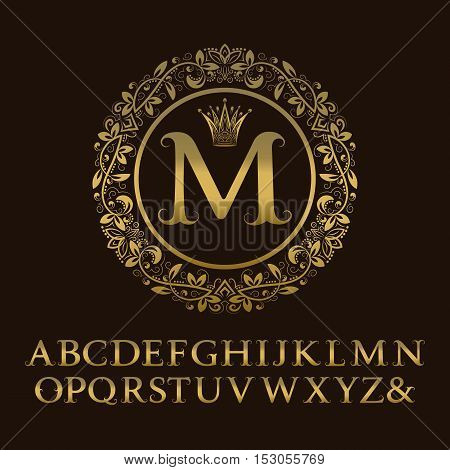 Tendrils gold letters with M initial monogram. Baroque style font for logo design. Isolated english vintage alphabet.