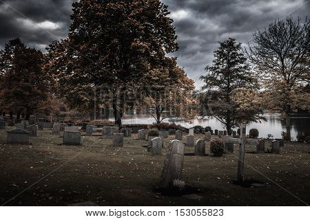 Dark halloween shot of old cemetery with gravestones without names
