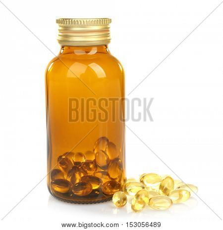 Cod liver oil capsules in glass bottle isolated on white