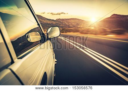 Road trip on sunset, car on the highway, conceptual image of escape and adventure travel, slow motion photo poster