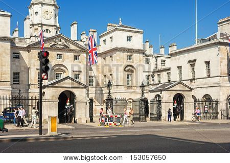 London UK - June 09 2006: A mounted trooper of the Household Cavalry on duty at Royal Horse Guard Palace at Whitehall. The soldiers charged with guarding the official royal residences in the United Kingdom.