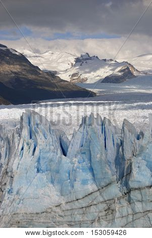 Hostile glacier Perito Moreno with mountain background