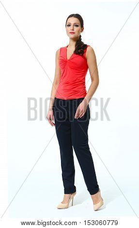 woman with straight hair style in summer red top casual black trousers high heels shoes full length body portrait standing isolated on white