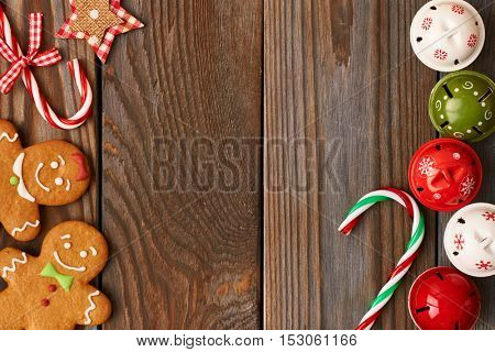Christmas homemade gingerbread cookies and decoration on wooden background