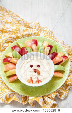 Apples with caramel cream cheese dip for Thanksgiving look like cute turkey