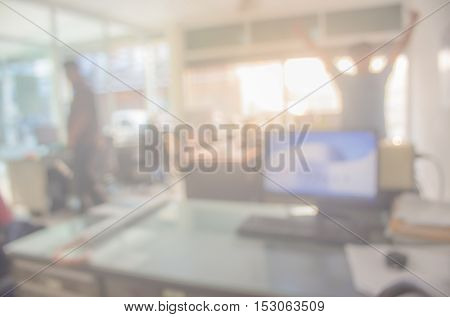 Businessmen blur in the workplace. Table Top And Blur Office of Background. abstract blur background table work in office with computer.