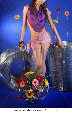 Attractive Girl Standing Between Two Rolls Of Wire