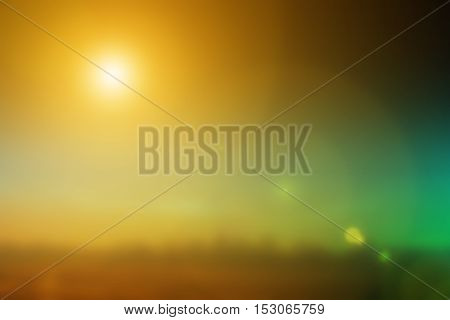 Natural background blurring warm colors and bright sunlight. bokeh background or Christmas background. Green Energy.