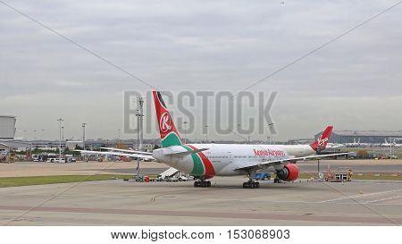 LONDON UNITED KINGDOM - NOVEMBER 25: Kenya Airways at Heathrow in London on NOVEMBER 25 2013. Boeing Airplane Kenya Airways Parked at Heathrow Airport in London United Kingdom.
