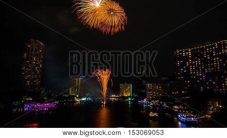 Firework on Chaopraya river Bangkok Thailand .