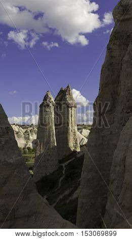 Prehistoric rock formations in front of Love valley in Turkey shot through rock slot