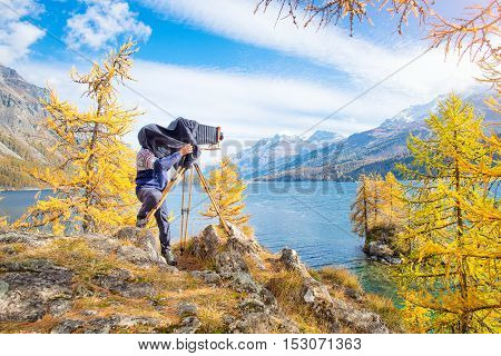 Landscape Photographer With Old Vintage Plate Camera