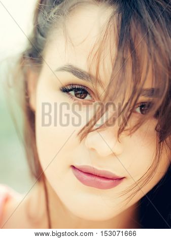 Young woman brunette with pretty cute face hazel eyes fashion natural makeup pink lips and perfect healthy skin