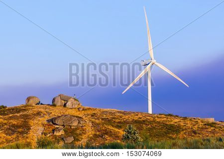 Windmill power generator and famous stone house in Guimaraes Portugal