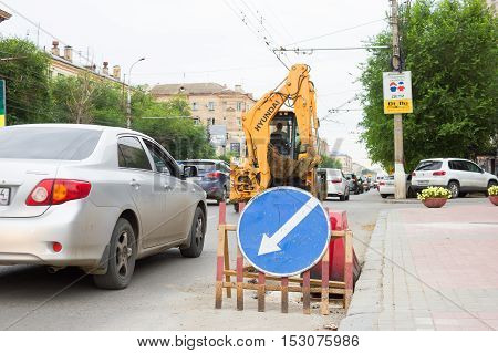 VOLGOGRAD RUSSIA - July 22 2016: A road sign of a detour of the dangerous site in rush hour established on the road