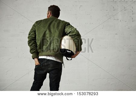 Man In A Khaki Pilot Jacket With Helmet