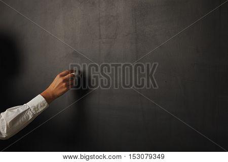 Teacher In White Blouse At The Blackboard