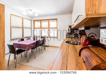 Colorful Modern Kitchen With Facilities And Wooden Floor With Rug