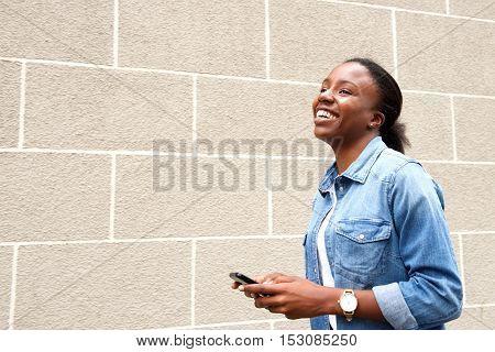 Happy Woman Using Mobile Phone Looking Away