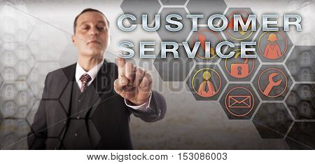 Mature businessman with perky expression and assertive gesture touching CUSTOMER SERVICE onscreen. Business metaphor and technology concept for customer experience management and technical support.