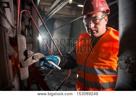 Russia - Oktober, 2016: worker at a factory that heats water