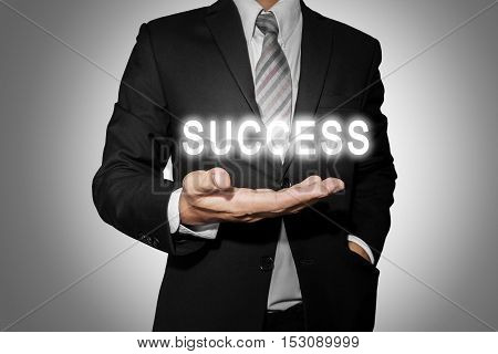 Businessman with bright SUCCESS text on hand, business success