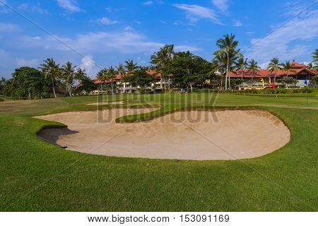 Golf field near Tanah Lot Temple in Bali Indonesia - travel background