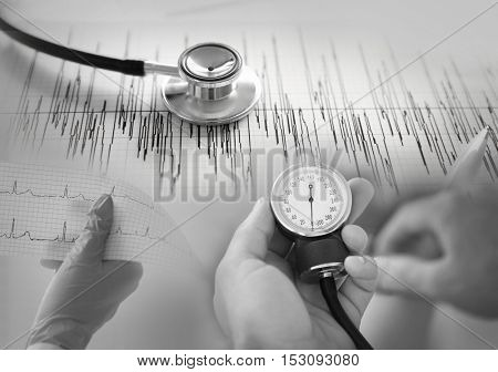 Medical equipment collage, closeup. Cardiology concept. Black and white photo.