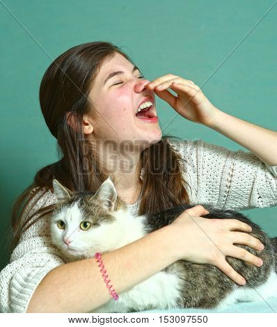 allergyc to cats teen girl sniffing with cat close up portrait
