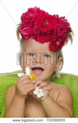 Smiling little girl with flowers isolated on white