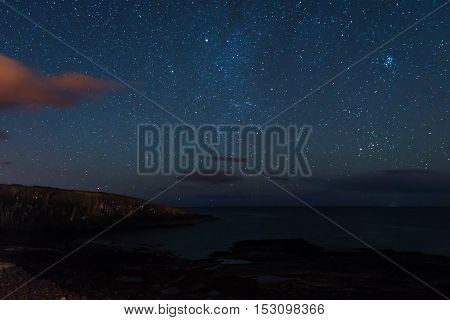 Stars over Cullernose Point, just south of Craster Village at night, on the Northumberland Coast