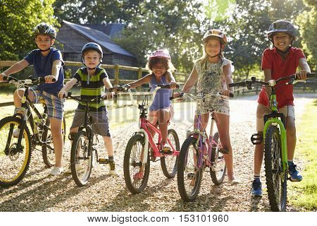 Portrait Of Five Children On Cycle Ride Together